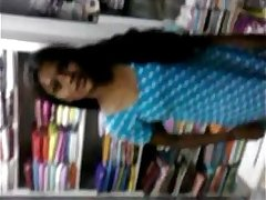 Indian young Student Relaxed on Inside Of book shop - Wowmoyback